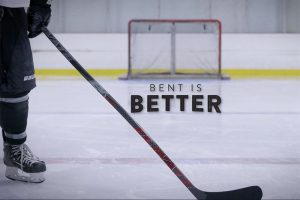 A picture of the Elevate Hockey stick used on ice