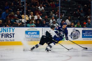 An ECHL player stickhandling in a game.