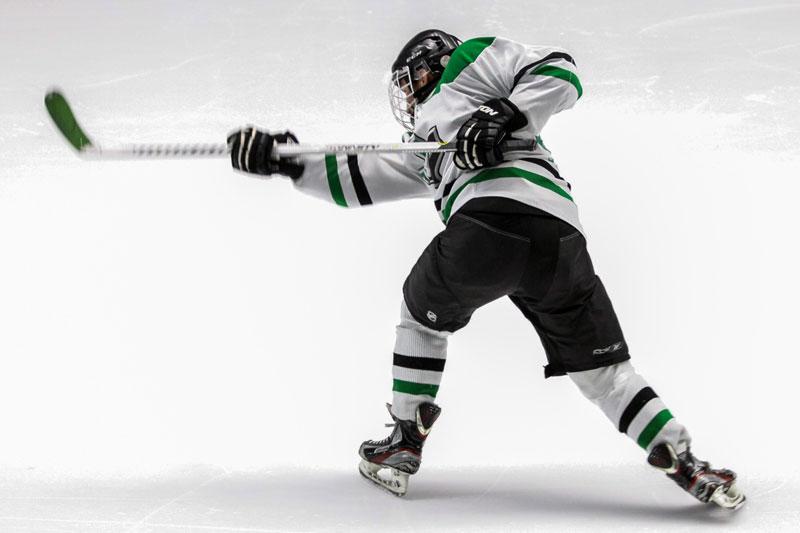 Hockey player finishing shot