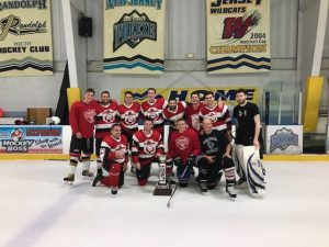A men's league team in matching hockey jerseys taking a team photo