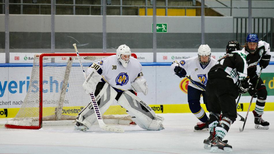 ice hockey goalie wearing a butterfly goalie pad