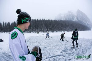 Hockey Community pick up hockey game on a pond in the mountains