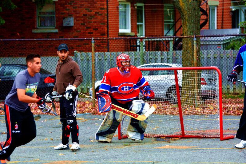 Guys playing street hockey
